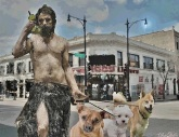 Cave man on his cell phone walking his dogs